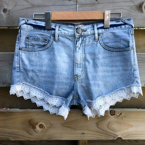 FREE PEOPLE high waisted distressed denim shorts